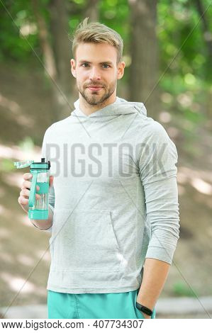Refreshing Vitamin Drink After Outdoor Workout. Man Athletic Appearance Holds Water Bottle. Guy Athl