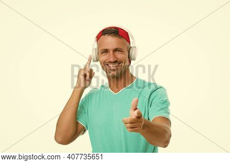 Join Along. Happy Man Pointing Straight Isolated On White. Handsome Guy Listen To Music Pointing Ges