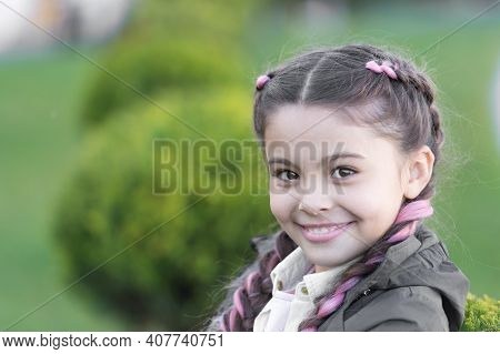 Add Bright Detail. Little Girl With Cute Braids Nature Background Close Up. Kanekalon Strand In Brai