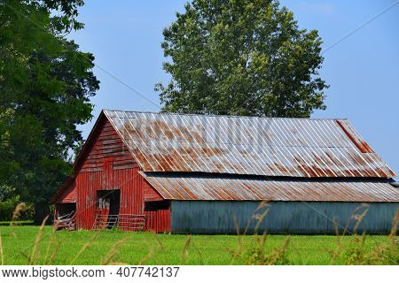 Red Wooden Barn With Tin Roof