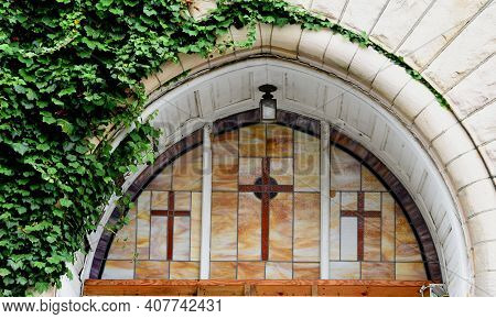 Arched Stained Glass Window On Church