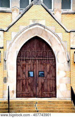 Catholic Church Has Brown Rustic Door