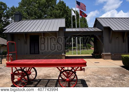 Historic Collierville Train Depot Has Antique Red Metal Baggage Cart, In Collierville, Tennessee.  S