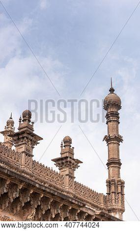 Vijayapura, Karnataka, India - November 8, 2013: Brown Stone Ne Corner Minaret And Roof Sculptures O