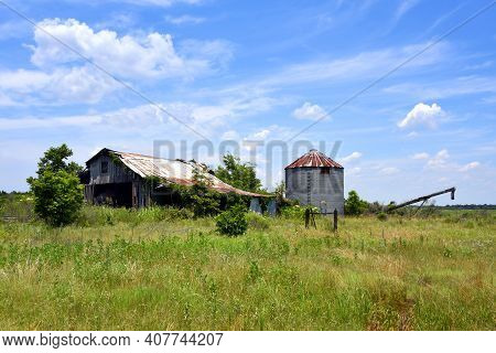 Derelict Barn With Rusting Silo