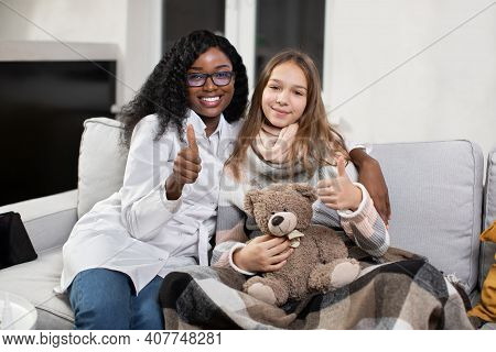 Patient Compliance, Doctors Visit At Home. Joyful Smiling Satisfied African Female Family Doctor And