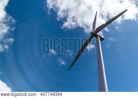 Wind Turbine Emits Powerful Gusts Of Energy. Single Wind Turbine Perspective Shot From Below