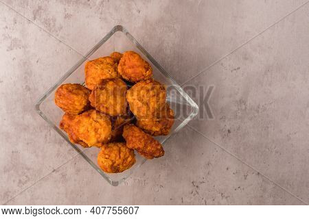 Closeup Of Some Chicken Nuggets In A Glass Dish On A Table Ready To Eat