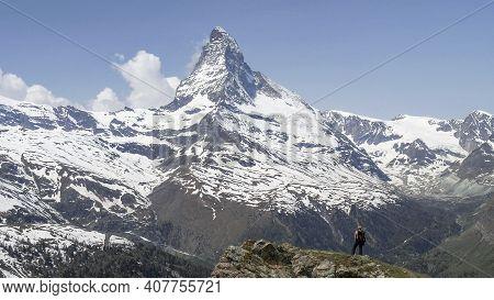 A Hiker Admiring The Matterhorn At Zermatt