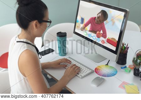 Caucasian female teacher using computer on video call with schoolboy learning from home. Online education staying at home in self isolation during quarantine lockdown.