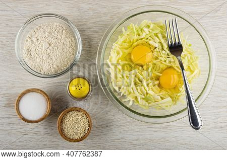Bowl With Wheat Flour, Transparent Bowl With Eggs, Chopped Cabbage, Fork , Bamboo Bowls With Sesame