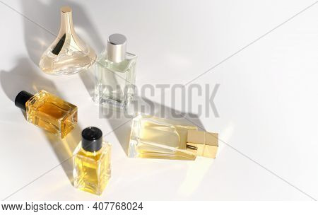 Various Perfume Bottles On A White Background. Travel Size Fragrance Bottles. Sample Mini Perfume Fo