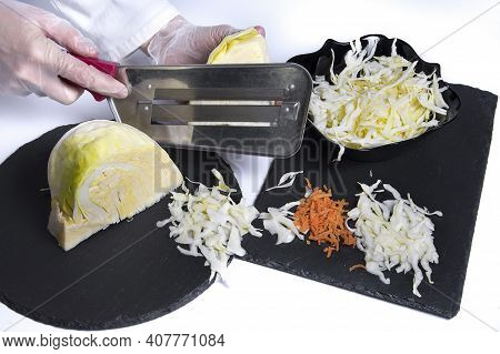 Women's Hands With Chopping Knife Cut Cabbage On The Cutting Board Preparing Slaw Salad Isolated On