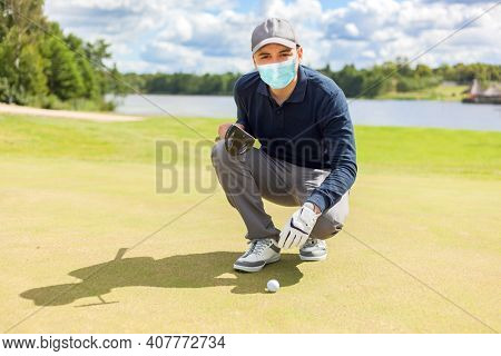 Golfer man playing while wearing a mask, covid coronavirus outdoor sport concept