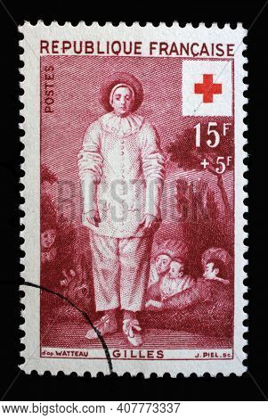 ZAGREB, CROATIA - JULY 03, 2014: Stamp printed in the France shows Pierrot (Gilles), Painting by Antoine Watteau, Series: Red Cross, circa 1956