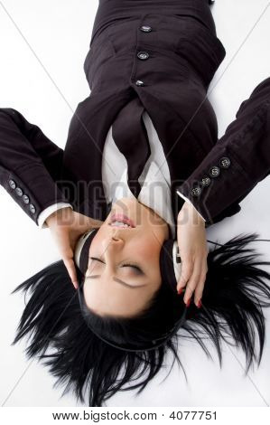 High Angle View Of Businesswoman Wearing Headphone