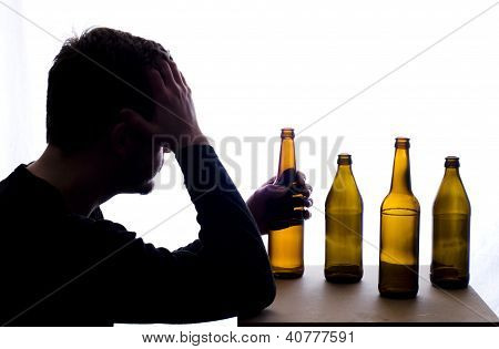 Troubled Man With Bottles Of Beer