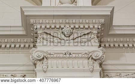 Column top, gypsum stucco molding with angel, wall texture and patterns