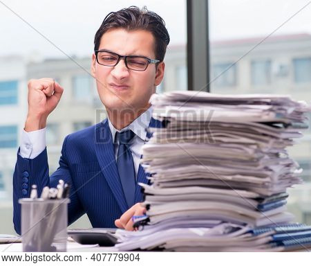 Workaholic businessman overworked with too much work in office