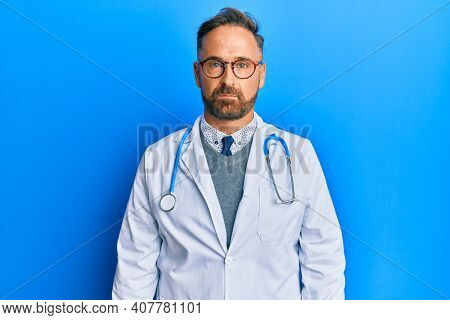 Handsome middle age man wearing doctor uniform and stethoscope depressed and worry for distress, crying angry and afraid. sad expression.