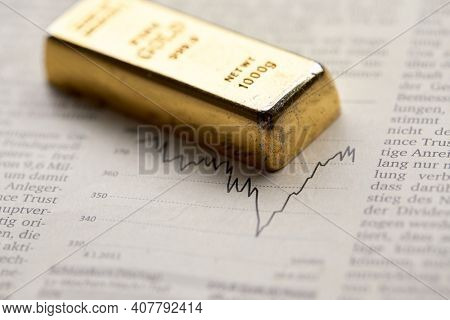 Gold bullion  on the graph as crisis safe haven, financial asset, investment and wealth concept.