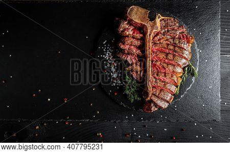 Sliced Steak T-bone Or Aged Wagyu Porterhouse Grilled Beef Steak Medium Rare On Stone Table. Menu Re