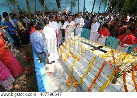 KUMROKHALI, INDIA - FEBRUARY 23, 2020: Bishop Shyamal Bose leads prayer at the tomb of Croatian missionary, Jesuit father Ante Gabric on the occasion of his 105th birthday in Kumrokhali, West Bengal,