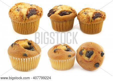 freshly baked blueberry and cherry muffins muffins on a white background
