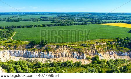 Aerial drone view - Beautiful summer landscape old chalk quarry. Bird view over nature landscape with old chalk quarry. Beautiful hilly.