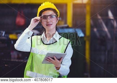 Women Industrial Plant With A Tablet In Hand, Engineer Looking Of Working At Industrial Machinery Se