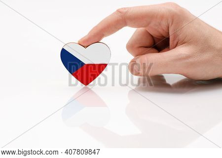 Love And Respect Czech Republic. A Man's Hand Holds A Heart In The Shape Of The Czech Republic Flag