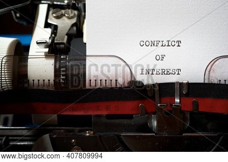 Conflict of interest phrase written with a typewriter.