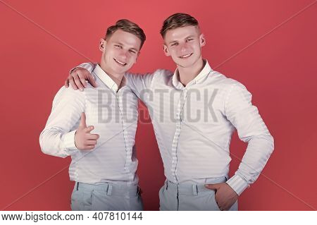 Brotherhood And Friendship Concept. Happy Men Hugging. Two Brothers Smiling And Pointing Finger. Mod
