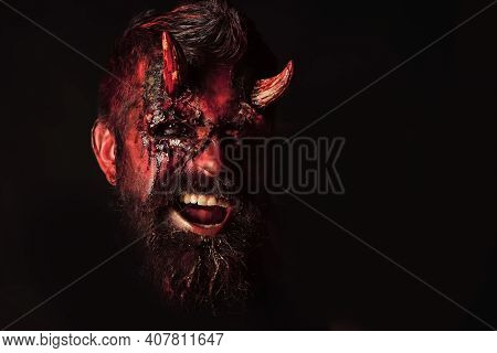 Halloween Devil. Demon With Bloody Horns, Eyes, Red Blood, Wounds. Darkness And Light Concept. Man E