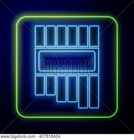 Glowing Neon Pan Flute Icon Isolated On Blue Background. Traditional Peruvian Musical Instrument. Za
