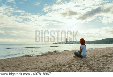 Summer Scenery At Baltic Sea On Rugen Island In Germany With A Young Woman Sitting On The Beach In T