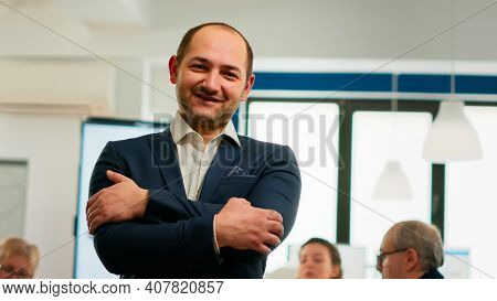 Young Man Project Manager Smiling In Front Of Camera Standing In Brainstorming Room, Preparing For M