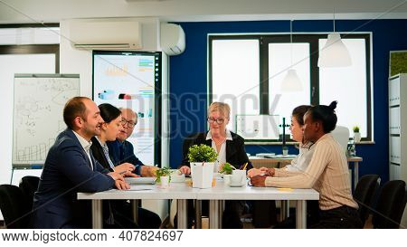 Business Team Starting Morning With Brainstorming Meeting Coming In Broadroom Discussing Company Pro