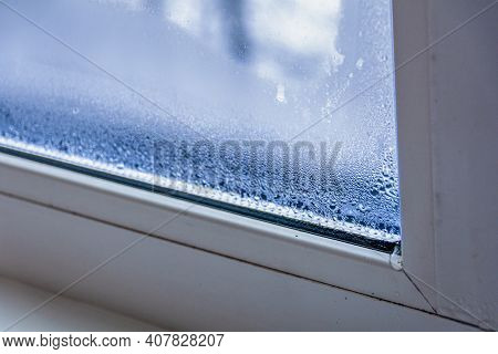 A Fragment Of A Plastic Window With Condensation Of Water On The Glass. Concept: Defective Plastic W