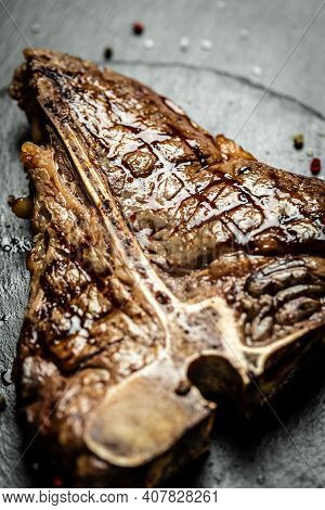 Beef T-bone Juicy Steak Rare Beef With Spices. American Cuisine. The Concept Cooking Meat. Medium Ra