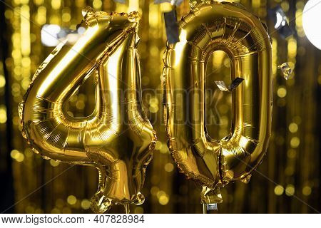 The Golden Number 40 Forty Is Made From An Inflatable Ball On A Yellow Background. One Of The Comple