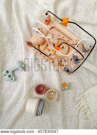 Gender Neutral Toys For Babies In Muted Soft Colors. Wooden Blocks En Bead Frame, Teething Toy, Bib,