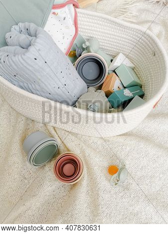 Gender Neutral Baby Shower Gift Set For A Newborn Baby In Soft Colors. Bibs, Building Blocks, Pacifi