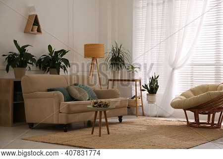 Stylish Living Room Interior With Comfortable Sofa And Cushions
