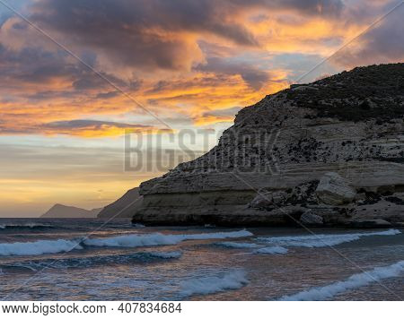A Beautiful Ocean Sunset On The Costa Del Sol In Spain With Beach And Cliffs In The Background