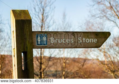 Sign To Bruce's Stone At Clatteringshaws Loch, Galloway Forest Park, Scotland