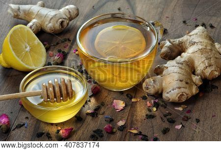Honey, Lemon, Ginger And A Cup Of Tea With Lemon On A Wooden Table. Traditional Cold Remedies