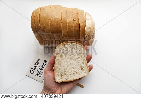 Gluten-free Sliced Bread. Gluten-free Sign. A Piece Of Bread In A Female Hand.bread On Sourdough, Mi
