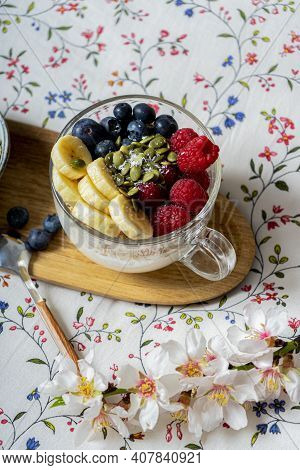 Tasty Fresh Breakfast In Bed On Wooden Table. Yogurt With Fruits. Vintage White Interior