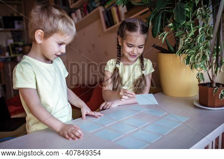 Happy Kids Playing At Board Game Memo In Domestic Interior, Family Values Actually, Stay At Home, Li